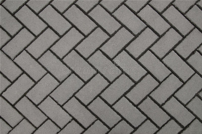 Wall gray background of tiles. Background of gray tiles laid out by a pattern stock photography