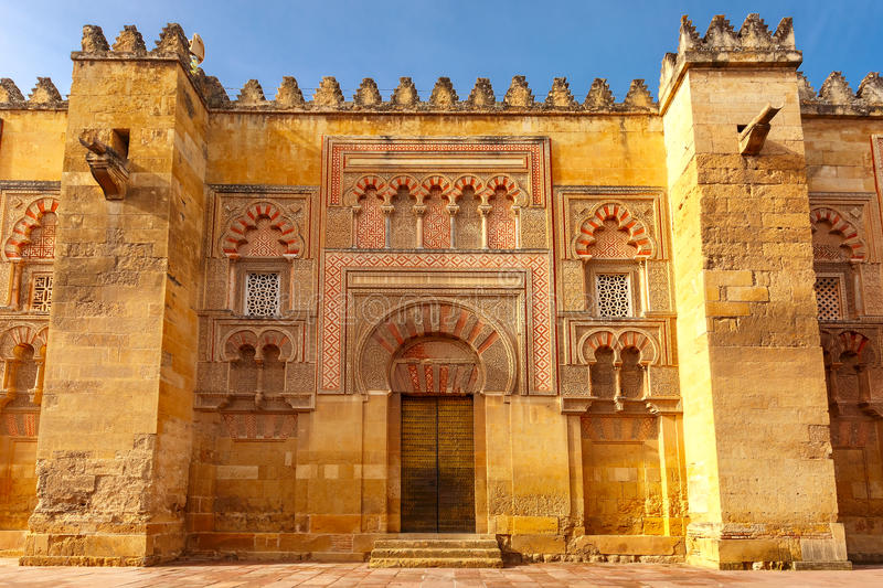 The wall of Great Mosque Mezquita, Cordoba, Spain. Puerta del Batisterio - the Fourth door of the east facade of the Great Mosque Mezquita, Catedral de Cordoba royalty free stock images