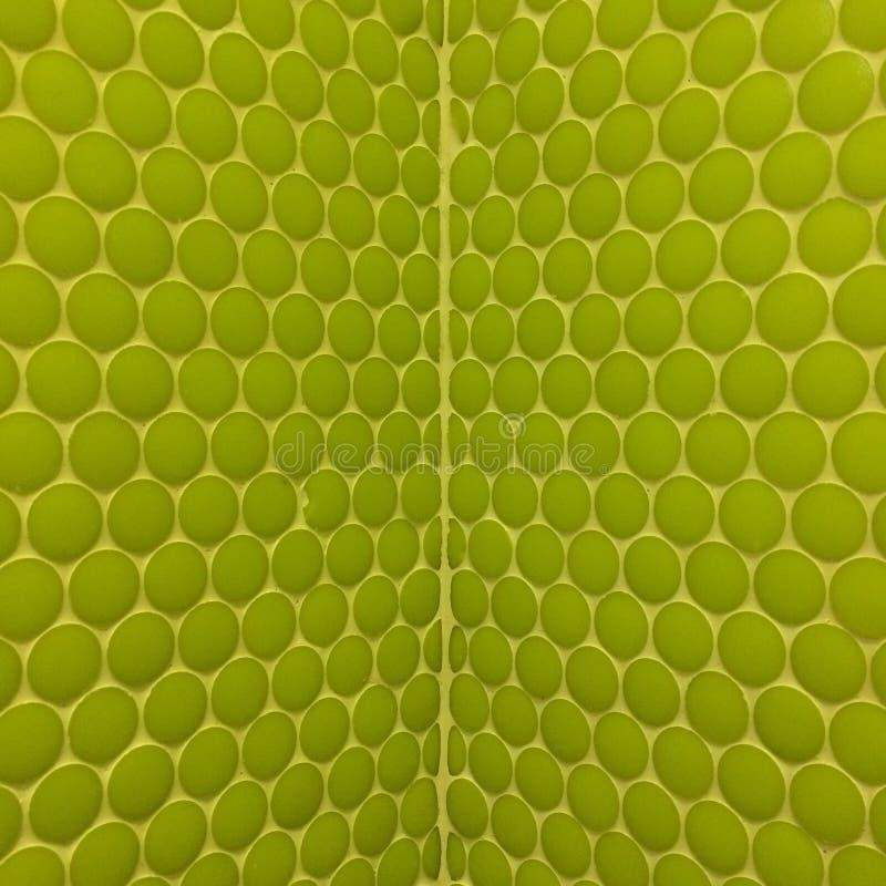 Wall with green mosaics stock photo