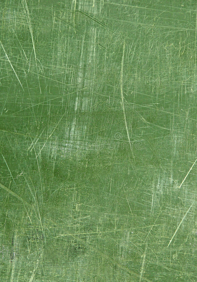 Wall with green scratched weathered pattern paint stock photo