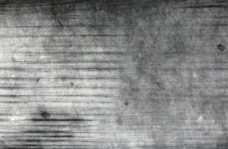 Wall with grey and white scratched weathered pattern paint stock image