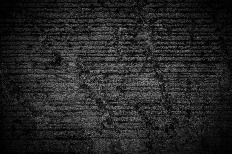 Wall grunge black concrete with light background. Dirty,dust wall concrete blackboard texture and splash white color space for tex stock photography
