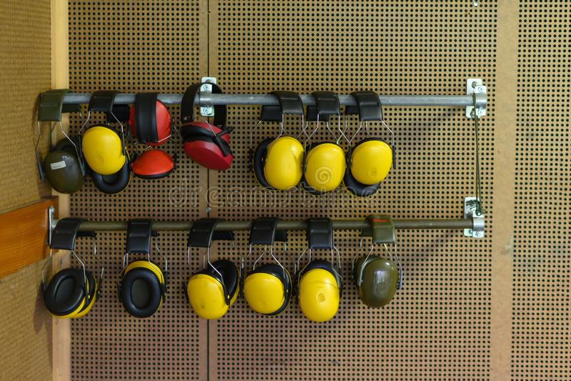 Wall with hearing protection at a shooting gallery royalty free stock photos