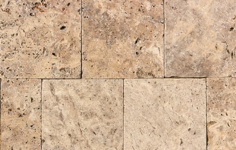 Wall of high quality travertine or thermolith. Blank for background or tile stock image