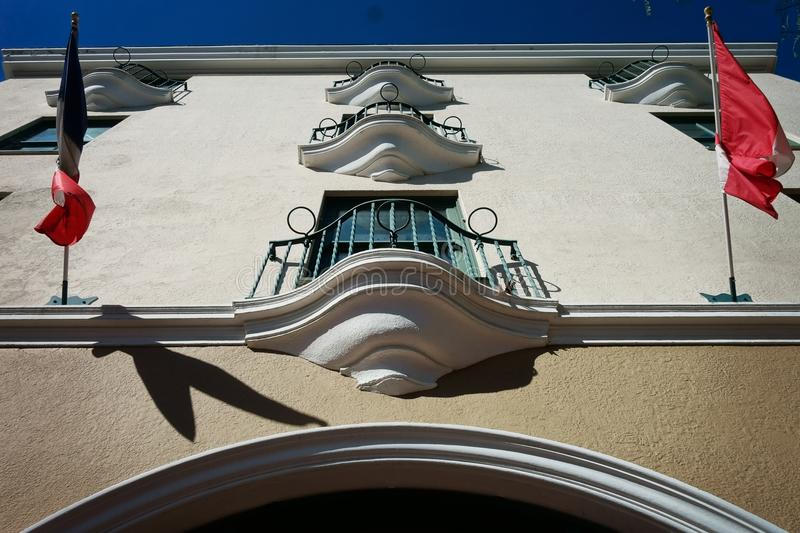 Looking up a wall at some classic old balconies stock photos
