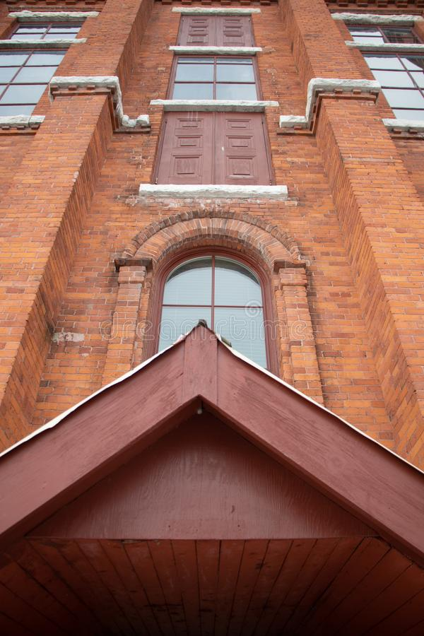 Wall of Historic Opera House Building in Orillia Ontario. Red brick walls and windows on the exterior of the Old Historic Opera House which still serves as an royalty free stock photo