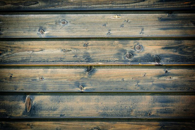 Wall from horizontal boards. Beautiful background with the texture of wooden slats. Photo with a vignette stock image
