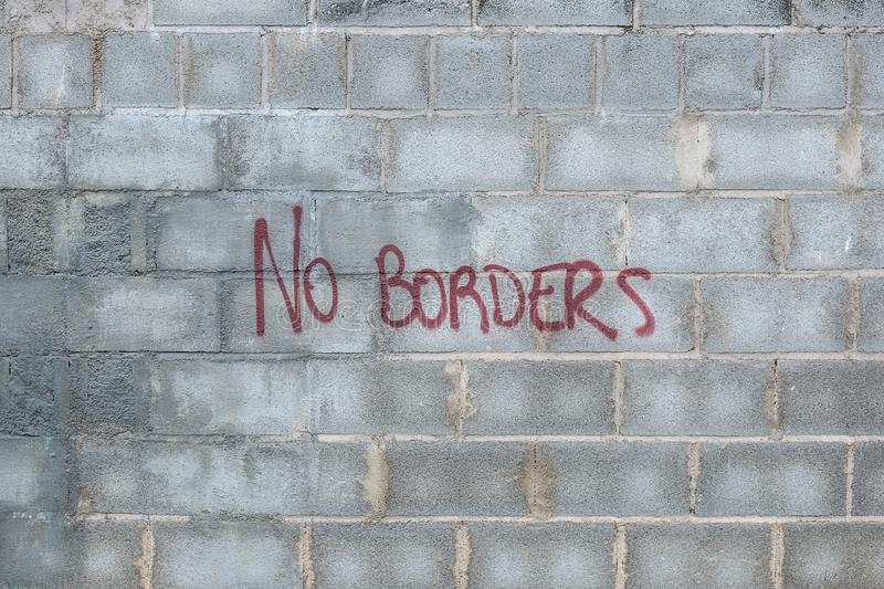 The wall with inscription no borders stock image