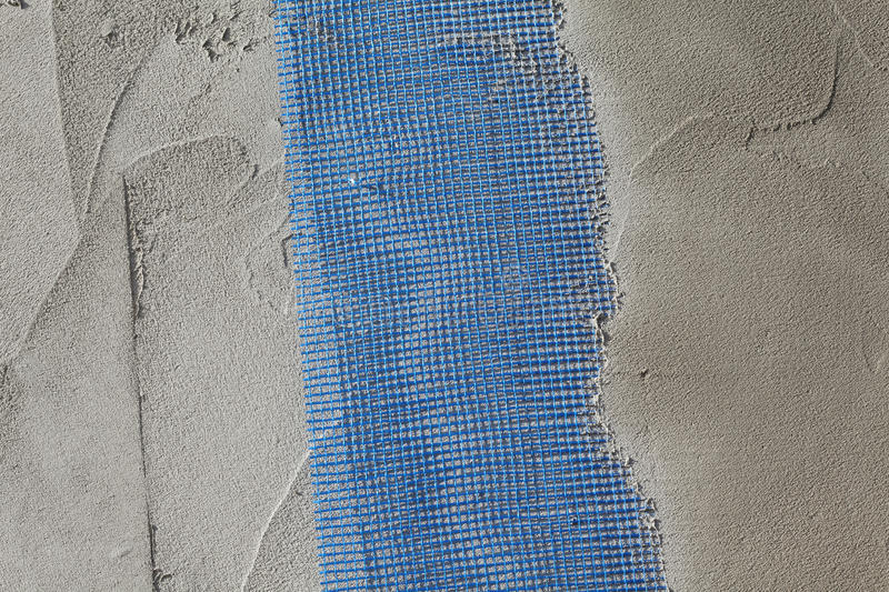 Closeup of layers over styrofoam insulation, mesh, plaster, cement ...