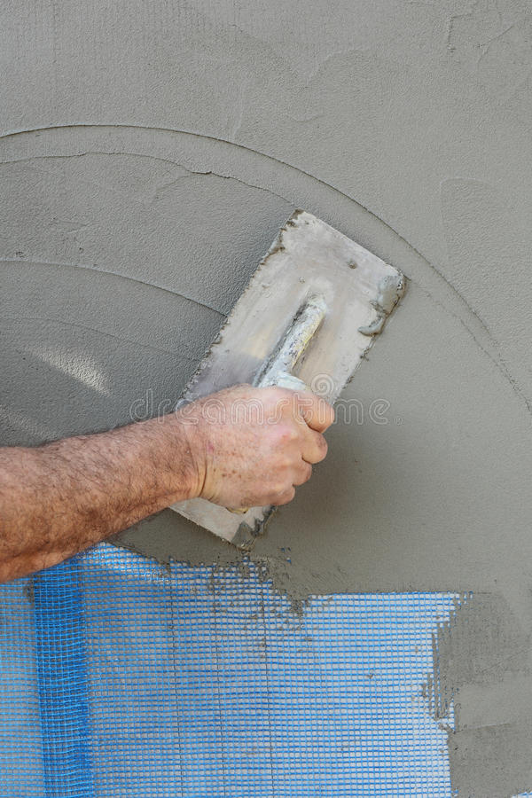 Worker placing mesh over styrofoam, polystyrene insulation and ...