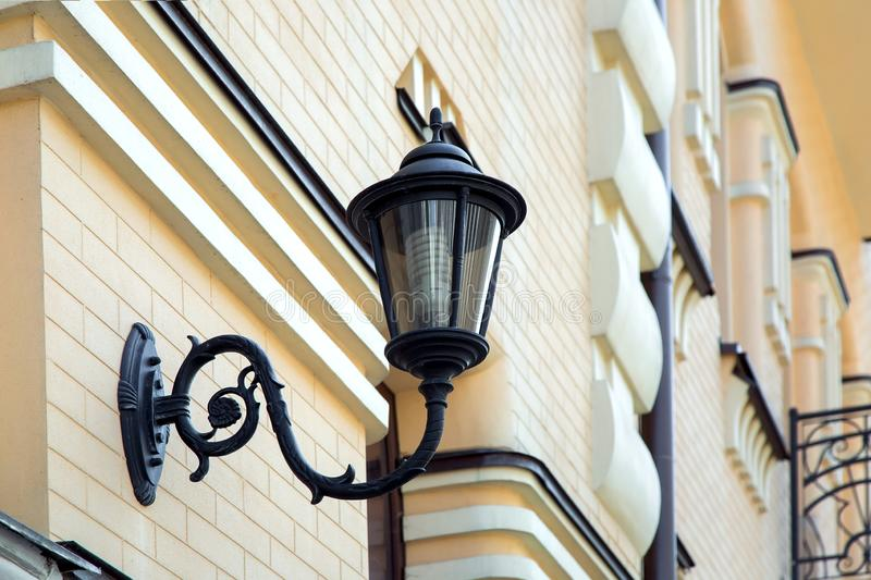 Wall lamp mounted on the facade. stock photography