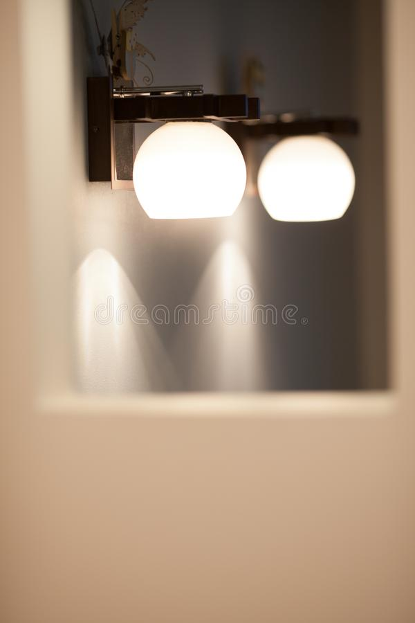 Wall lamps with white shade royalty free stock photos