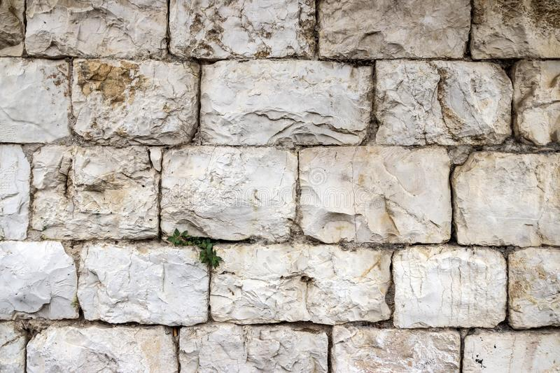 A wall of large blocks of Jerusalem stone stock photos