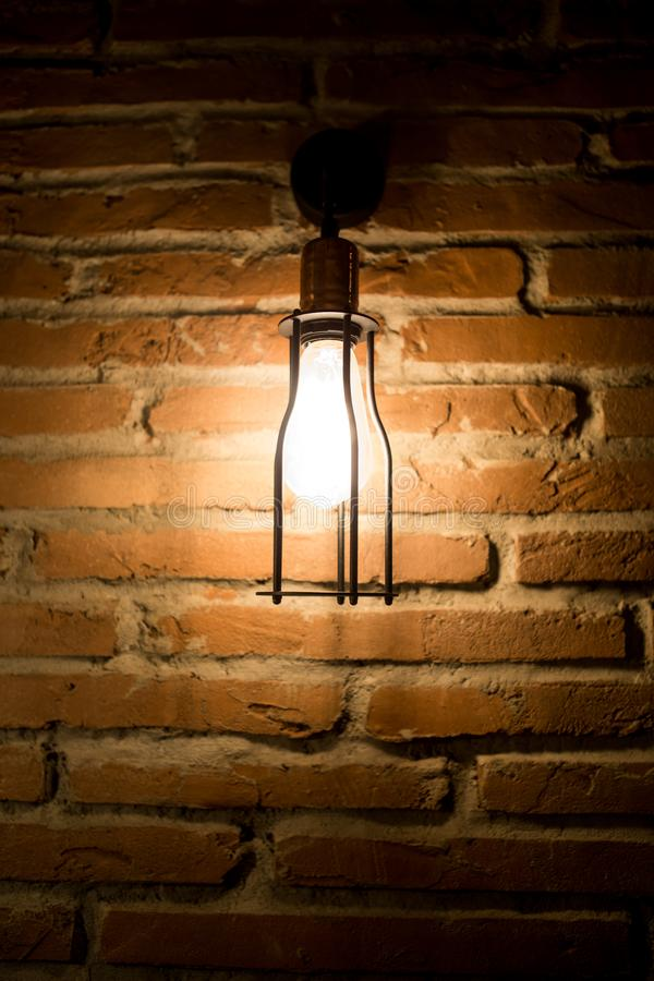 Wall light on brick and shade. Lights wall abstract background stock image