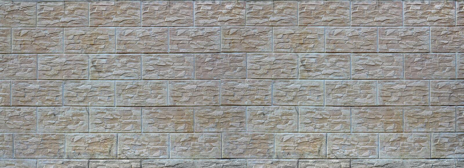 Wall of light texture tiles, stylized in appearance as a brick. One of the types of wall decoratio royalty free stock images