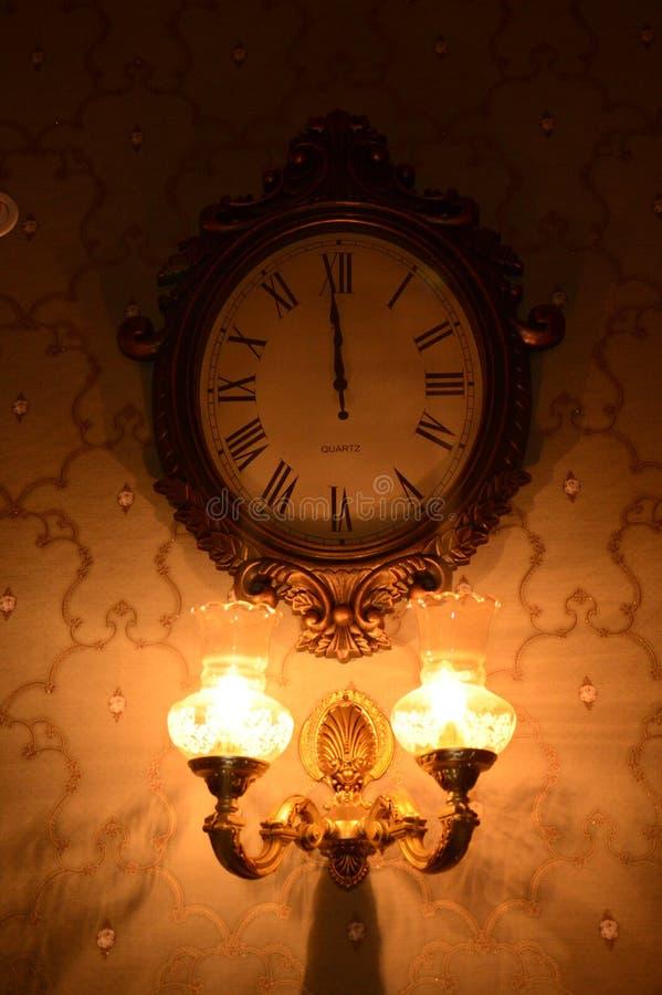 Wall Light & Watch stock photography