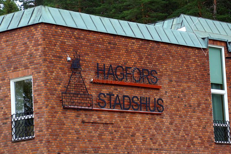 Wall logo of the town hall of Hagfors, Sweden. Hogfors, Sweden - August 4, 2019: Wall logo of the town hall of Hagfors, Sweden stock images