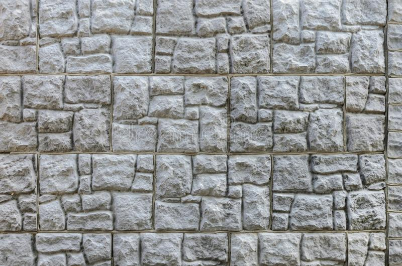 Wall made of artificial stone. Finishing the facade of the building. Texture royalty free stock image