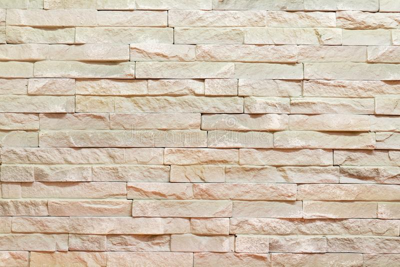Wall made of decorative brown stone. Background stock images