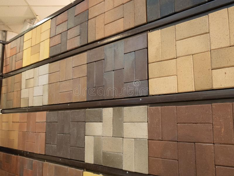 Wall made of different samples of sidewalk pavement bricks stock photography