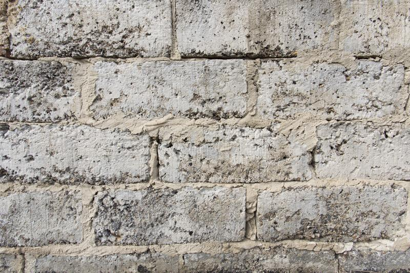 A wall made of grey bricks stock photography