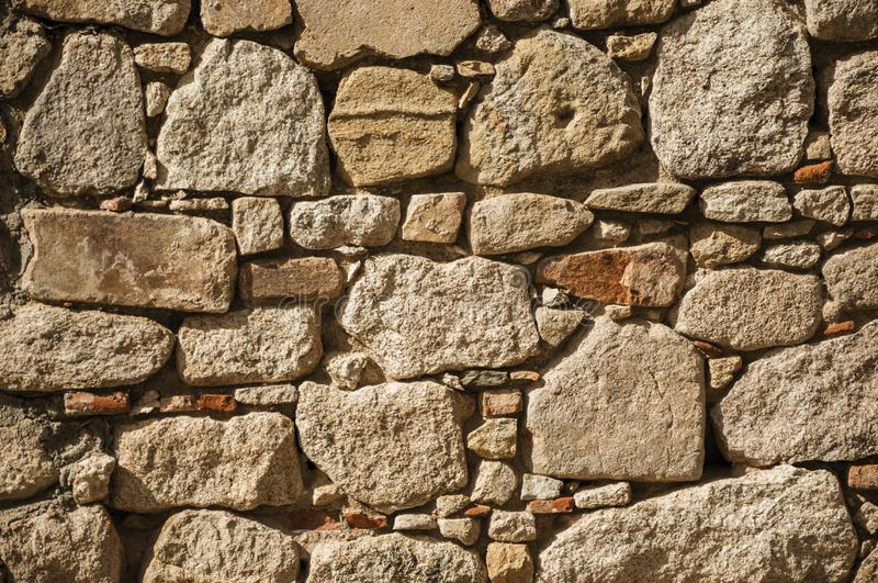 Wall made of rough stones forming a singular pattern at Trujillo. Close-up of wall made of rough stones in a sunny day forming a singular pattern at the Castle stock photos
