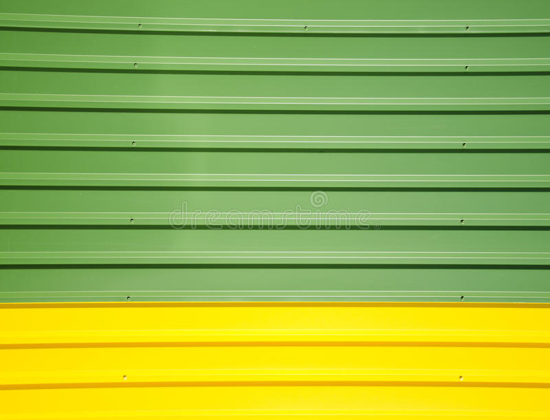 Wall made ??of tin metal steel. Stainless building. Background wall made ??of tin metal steel. Stainless steel industrial building wall royalty free stock images
