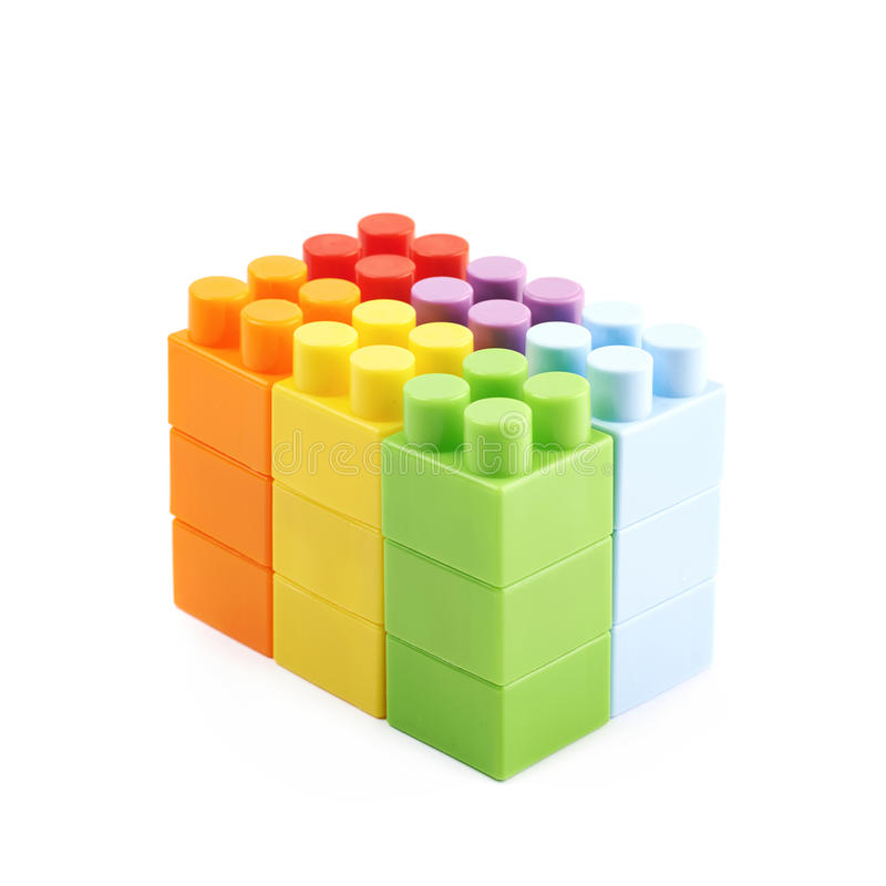 Wall made of toy bricks isolated. Wall made of plastic construction toy bricks isolated over the white background stock photos