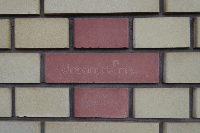 Wall made of yellow and orange bricks. Wall made of pale yellow and orange bricks royalty free stock image