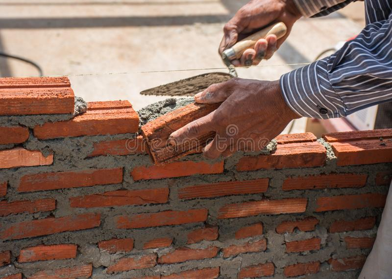 Masonry. Wall Masonry Worker Before plastering and painting stock images