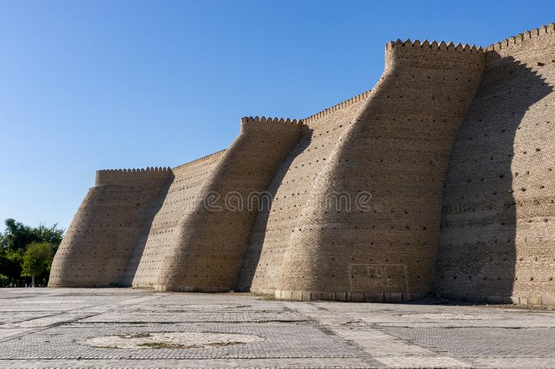 Wall of the massive Ark fortress. Located in the city of Bukhara, Uzbekistan stock photos