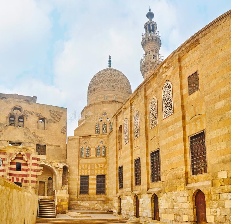 The mosque and residence of Amir Khayrbak Funerary Complex, Cairo, Egypt. The wall of the medieval residence and the carved dome of the mosque of historic Amir stock photo