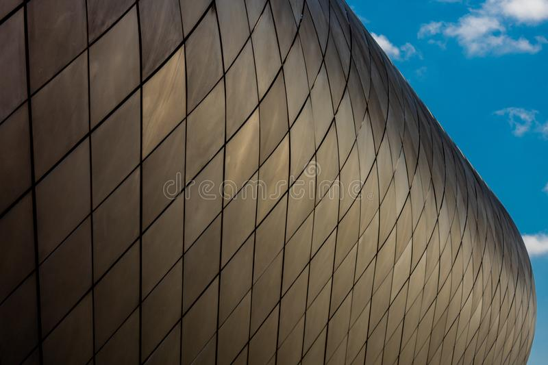 The wall of a modern building against the sky stock images