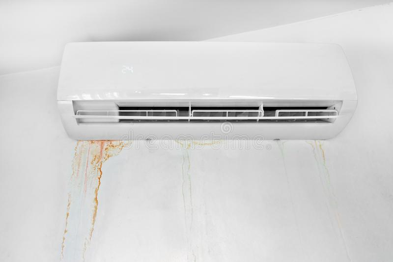 Wall with mold stain due to air conditioner leakage. Mildew stains and destruction of the wall. Improper installation of device royalty free stock photography