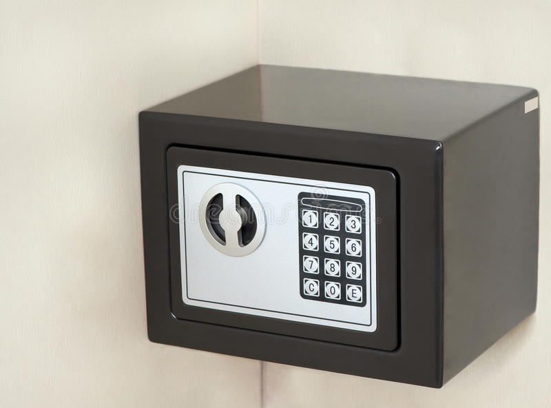 Wall mounted safe stock photography