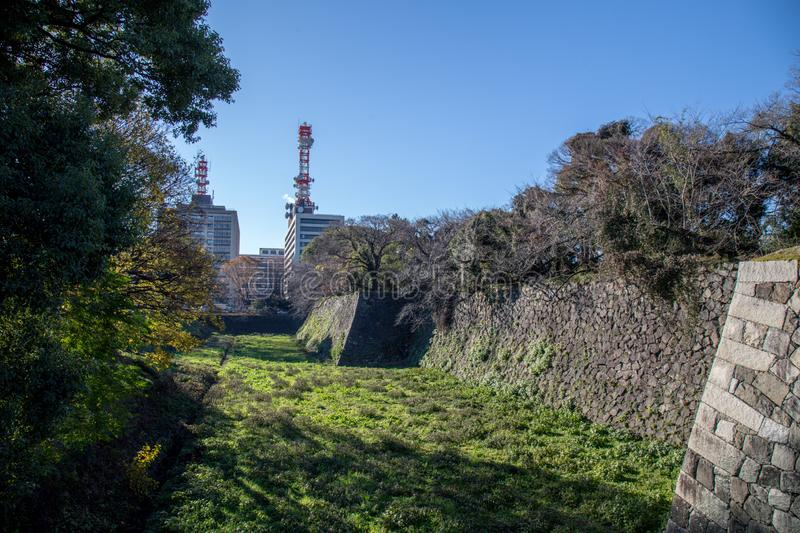 Wall of Nagoya castle in Japan. Nagoya, Japan - December 2018 : Area around Nagoya Castle in winter. Famous castle in Japan with green roof. Located in 1-1 royalty free stock photo