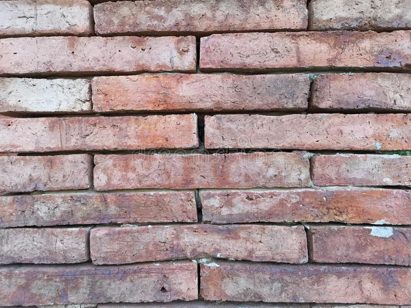 Wall of natural old brown color clay brick in background royalty free stock photography