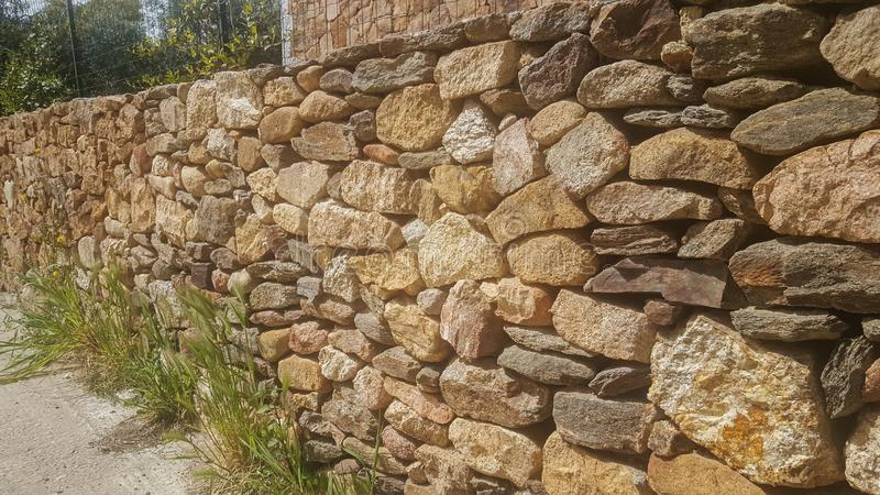 Wall of natural sand stones stock photography