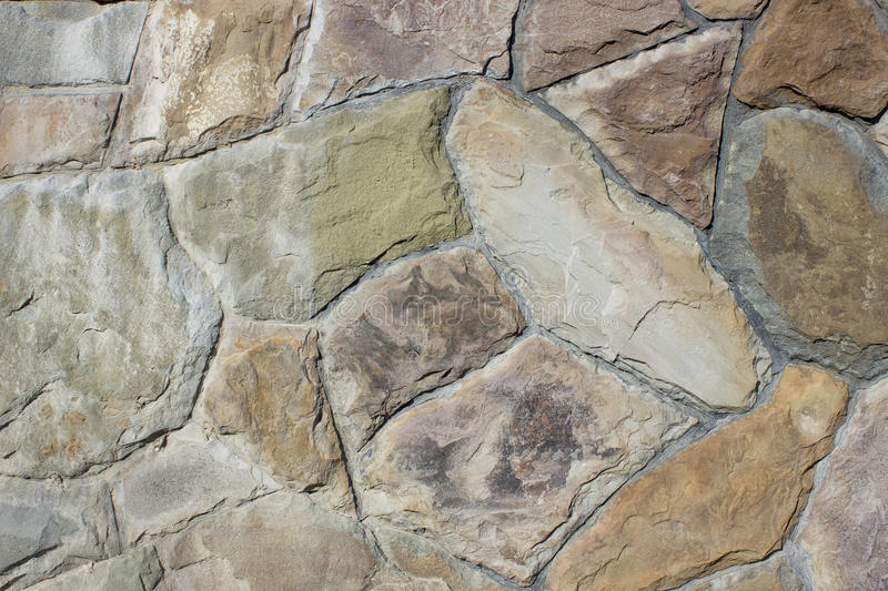 Wall of natural stone. Decorative wall of natural stone stock photos