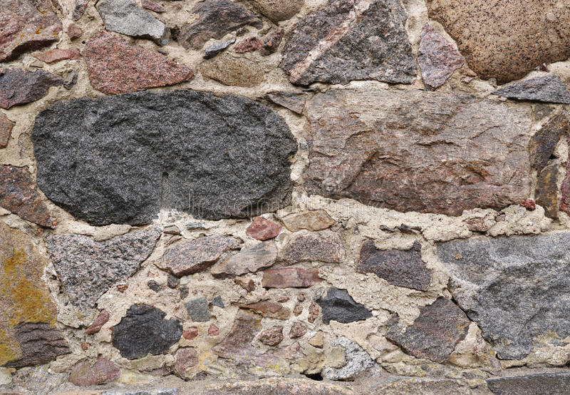 Wall of natural stone royalty free stock photography