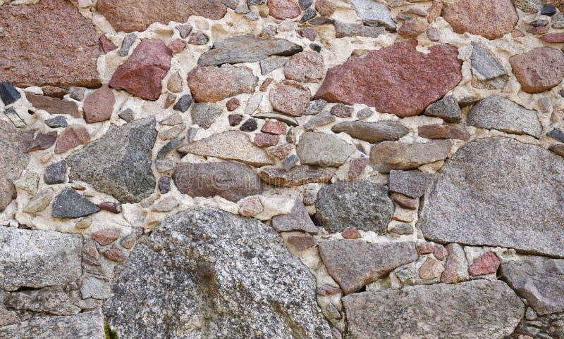 Wall of natural stone royalty free stock image