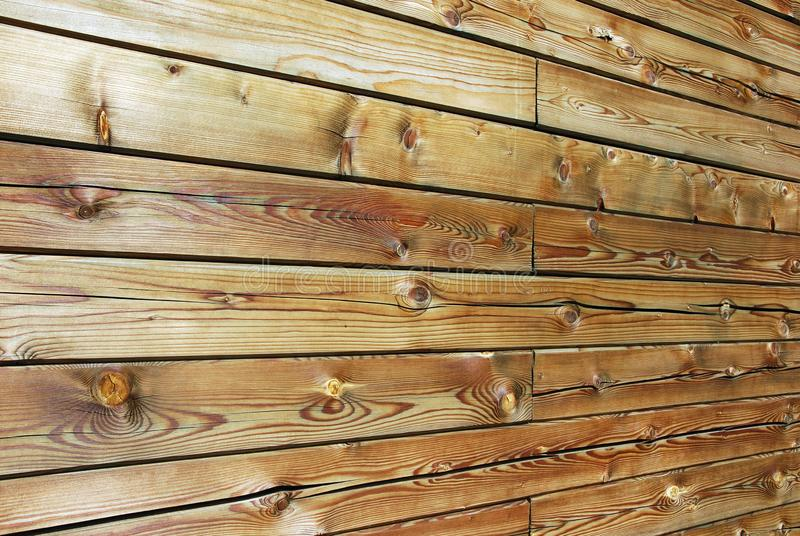 Natural wood timber texture background, tilted. Wall of natural wood timber, beautiful wood texture,weather  darkened, tilted shot, perspection lines, annual royalty free stock photography