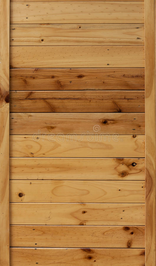 Wall of natural wooden planks of different shades. Textural background stock image