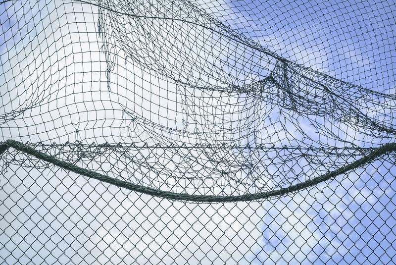 Wall of net over cloudy blue sky royalty free stock images