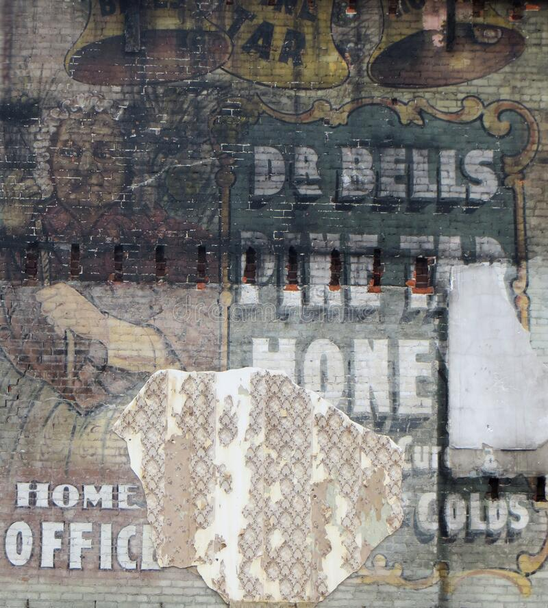wall with old advertising 2 stock photography