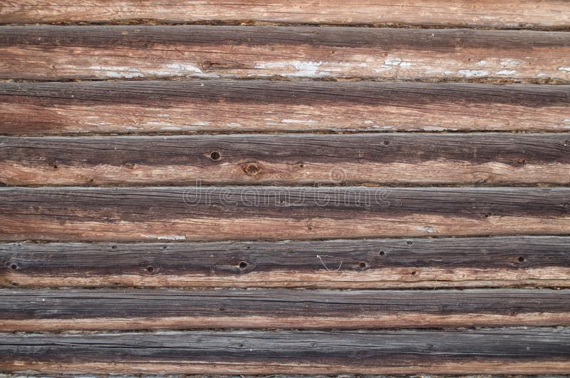 Wall of old blackened logs royalty free stock photography