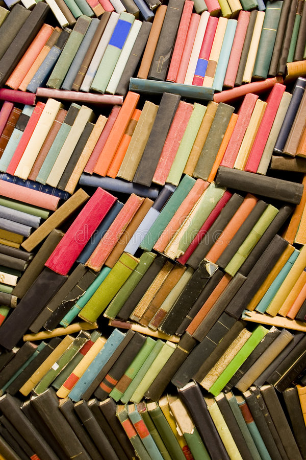 Wall of old books. Looking at the spines royalty free stock image