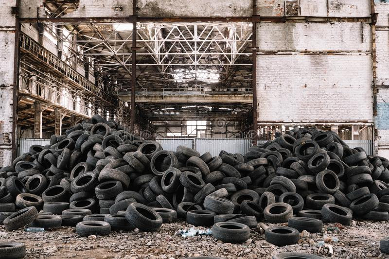 Wall of old car tires in the old factory stock photo