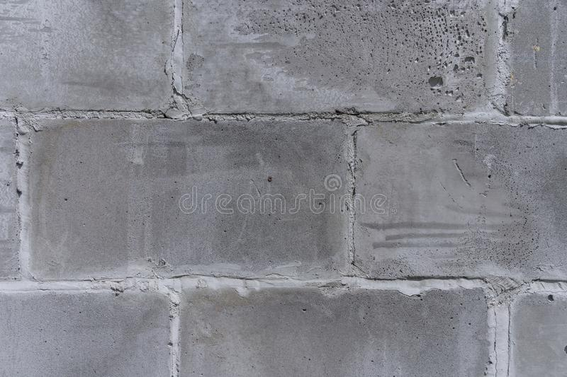 The wall of the old city, built of concrete, gray, porous, shabby blocks texture fragment royalty free stock photos