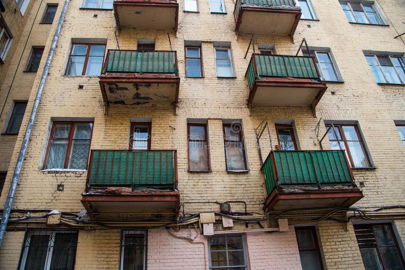 Wall of an old high-rise building with orange balconies royalty free stock photography